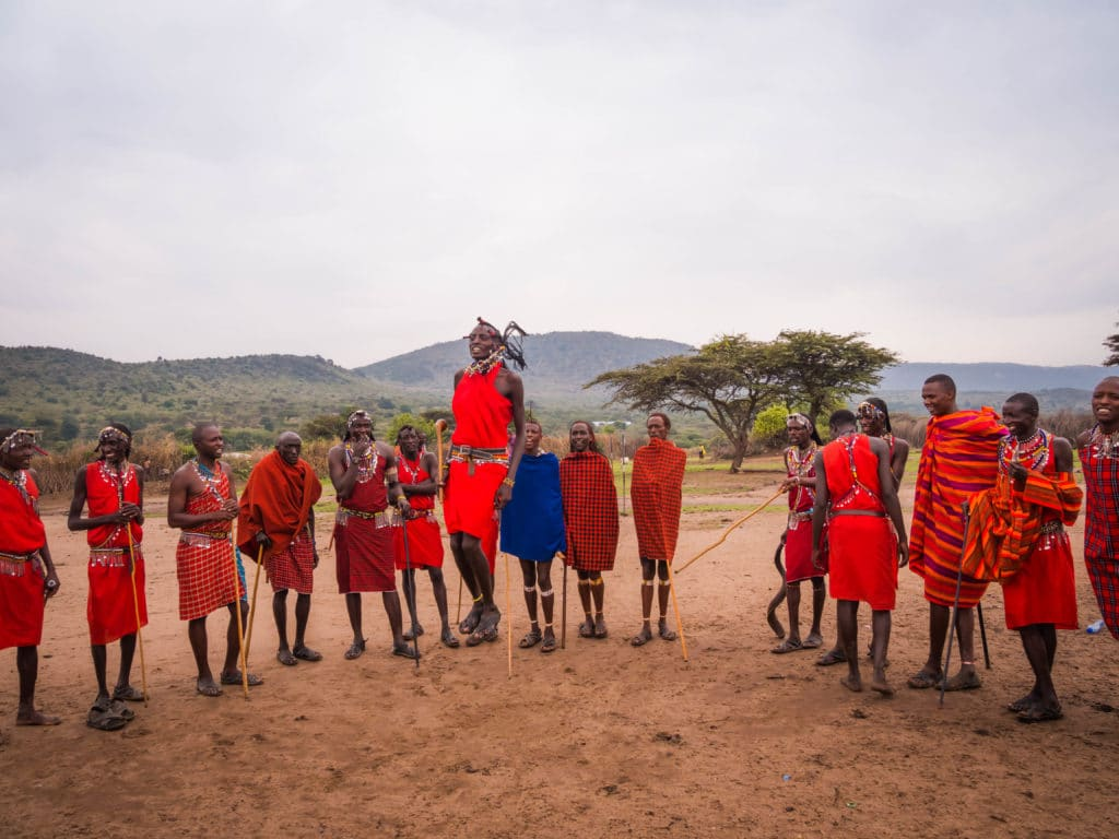 Travel - Visiting a Maasai Village - young Maasai man demonstrating adamu or the jumping dance