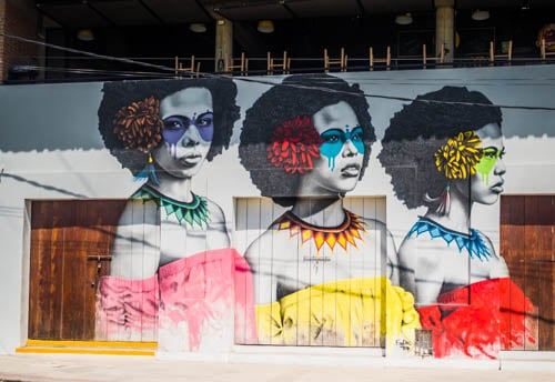 Three Afro Latina women depicted in street art in Cartagena Colombia