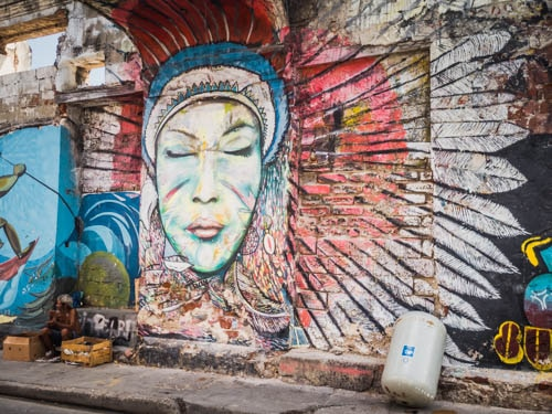 Graffiti Woman depicted in street art in Cartagena Colombia